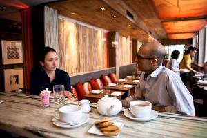 Interviewing the delightful chef Jehanjir Mehta for my column. I look SO TIRED in all of Brent's photos!